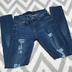 Express Distress Mid Rise Legging Fit Jeans